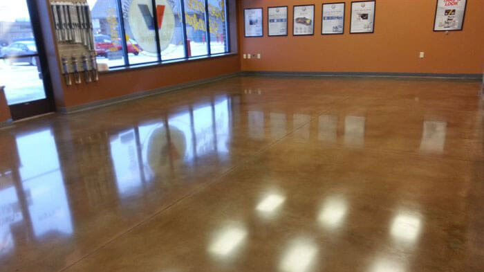 concrete floor with orange walls.