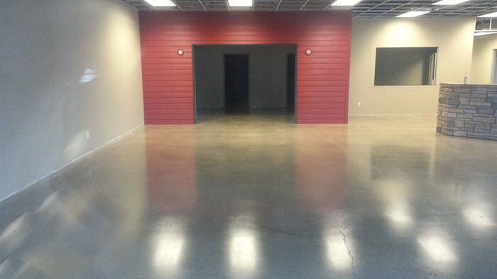 concrete floor with red wall.